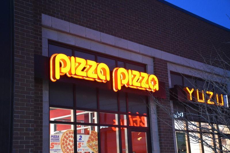 pizza pizza backlit sign
